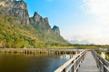 Boardwalk on the lake with mountain in national park - PhotoDune Item for Sale