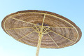 Wicker parasol and blue sky - PhotoDune Item for Sale
