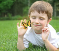 Little Boy Catching Spring Butterfly Outside - PhotoDune Item for Sale