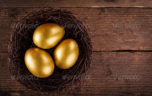 golden eggs in the nest - Stock Photo - Images