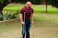 Muscular bald man on crutches - PhotoDune Item for Sale