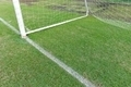 Traditional green grass soccer field with white chalk line - PhotoDune Item for Sale
