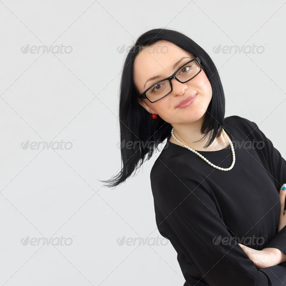 portrait of a serious brunette girl with long hair - Stock Photo - Images
