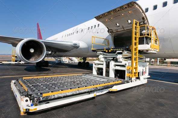 Loading cargo plane - Stock Photo - Images