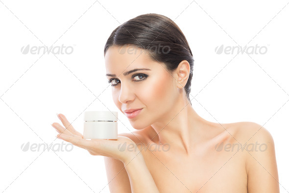 Gorgeous woman holding skin cream - Stock Photo - Images