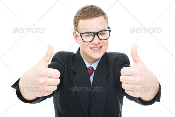 Successful businessman showing thumbs up - Stock Photo - Images