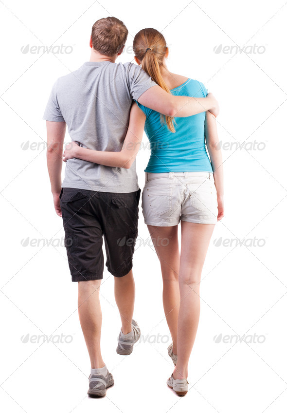 Back view of going young couple - Stock Photo - Images