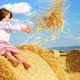 small rural girl on harvest field with straw bales - PhotoDune Item for Sale
