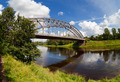 Steel Arch Bridge on river Msta in Borovitchi. Novgorod region, Russia. - PhotoDune Item for Sale