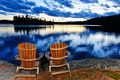 Wooden chairs at sunset on lake shore - PhotoDune Item for Sale