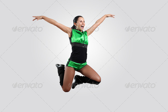 Young female dancer against white background - Stock Photo - Images