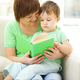 Mother is reading book for her son - PhotoDune Item for Sale