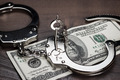 Handcuffs And One Hundred Dollars On The Table - PhotoDune Item for Sale