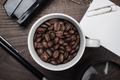 Cup Of Coffee Beans On Wooden Table In The Office - PhotoDune Item for Sale