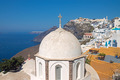 Church in Fira with Imerovigli in the back - PhotoDune Item for Sale