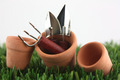 Clay pots on grass with garden tools - PhotoDune Item for Sale