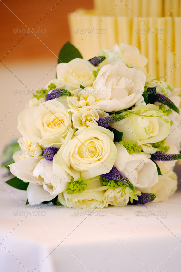 Yellow roses and cake at wedding - Stock Photo - Images