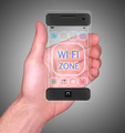 Transparent Mobile Smart Phone in man's Hand showing WI-FI Zone - PhotoDune Item for Sale