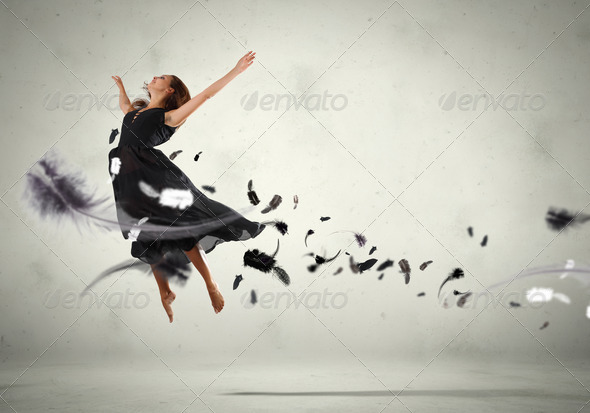 Young girl floating - Stock Photo - Images