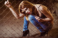 Beautiful young girl sitting behind metallic lattice - PhotoDune Item for Sale