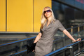 Blond woman in sunglasses against office windows - PhotoDune Item for Sale