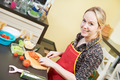 smiling woman cooking in her kitchen - PhotoDune Item for Sale