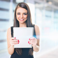 Businesswoman in front of office building holding tablet - PhotoDune Item for Sale