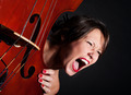 Girl face screaming by double bass - PhotoDune Item for Sale