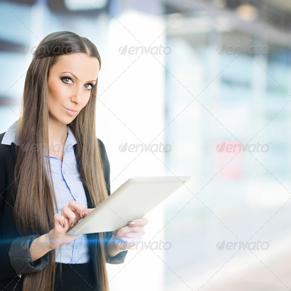 Businesswoman at work using digital tablet - Stock Photo - Images