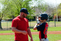 Baseball coach and teen player - PhotoDune Item for Sale