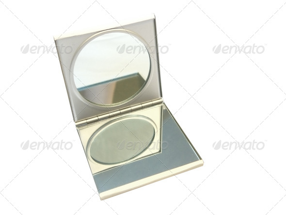 Small female mirror for a make-up - Stock Photo - Images