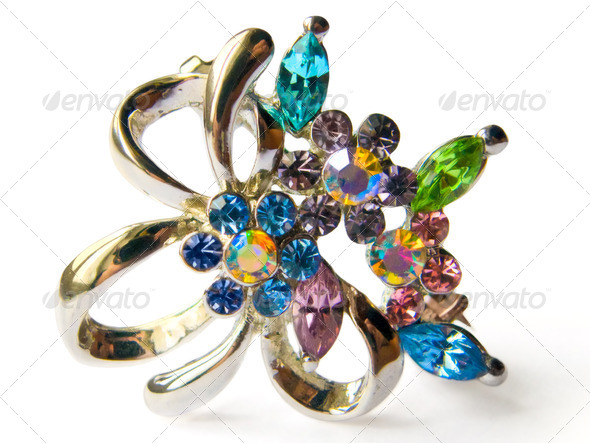 women's jewelry, decorative brooch with colored phianites, isolated on a white background - Stock Photo - Images