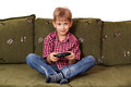 boy sitting on bed and play video game - PhotoDune Item for Sale