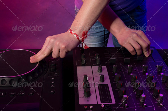 Crop of hands and technique of working DJ - Stock Photo - Images