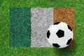 soccer ball on Flag Republic of Ireland as a painting on green g - PhotoDune Item for Sale