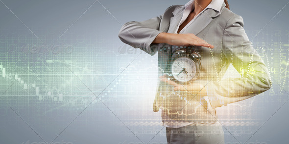 Business woman holding alarmclock - Stock Photo - Images