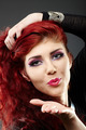 Beautiful redhead blowing kiss - PhotoDune Item for Sale