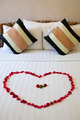 Heart of rose petals laid out on the bed - PhotoDune Item for Sale