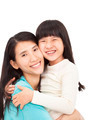 happy little girl hugging with her mother - PhotoDune Item for Sale