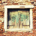 Glimpse of an old window with stone wall - PhotoDune Item for Sale