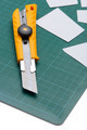 Box Cutter Knife just Cutting white paper on cutting mat isolated on white background - PhotoDune Item for Sale