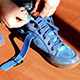 Girl Tying Shoelaces on Sneakers - VideoHive Item for Sale