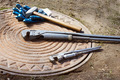 Hammer and wrench are on a manhole - PhotoDune Item for Sale