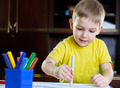 Cute little boy drawing with felt-tip pen - PhotoDune Item for Sale