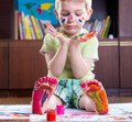 Boy with colorful  painted hands and foot - PhotoDune Item for Sale