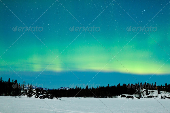 Northern Lights Aurora borealis winter landscape - Stock Photo - Images