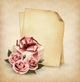 Retro holiday background with pink roses and gift box and old paper.  - PhotoDune Item for Sale