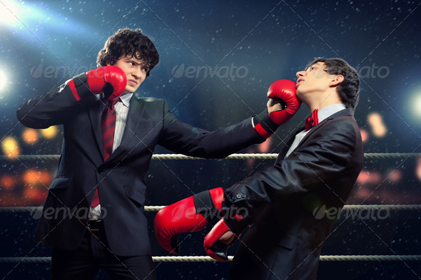 Two young businessman boxing - Stock Photo - Images