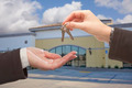 Real Estate Agent Handing Over the Keys in Front of Vacant Business Office. - PhotoDune Item for Sale