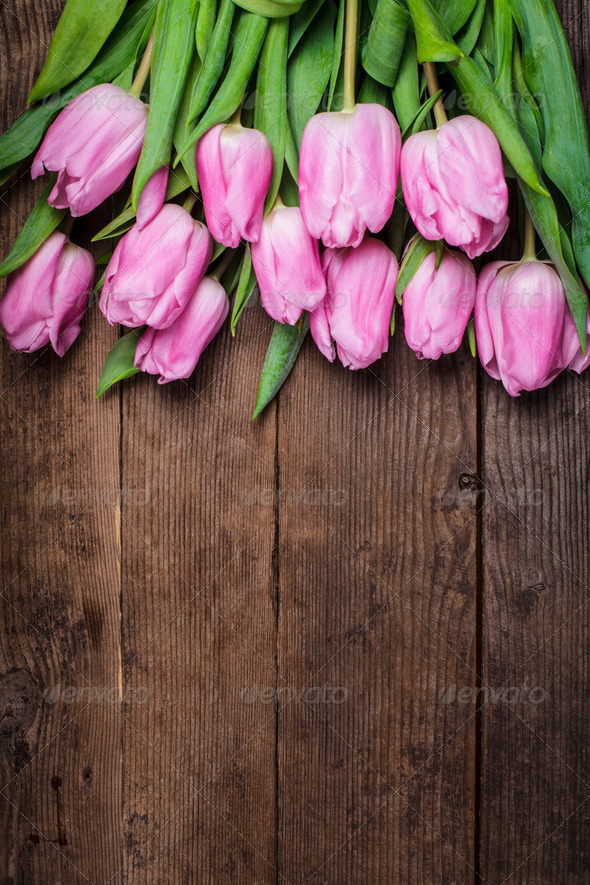 Pink tulips over wooden table - Stock Photo - Images